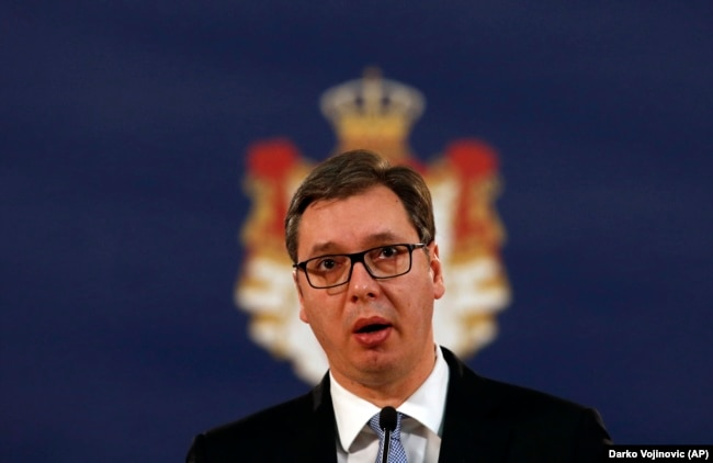 Serbian President Aleksandar Vucic peaks to reporters in Belgrade on January 16.