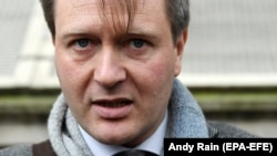 Richard Ratcliffe, the husband of jailed British-Iranian aid worker Nazanin Zaghari-Ratcliffe speaks to the press following a meeting with British Prime Boris Johnson at 10 Downing Street on January 23.
