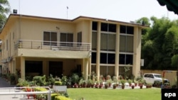 An exterior view of the sealed offices of the international charity Save The Children in Islamabad on June 12