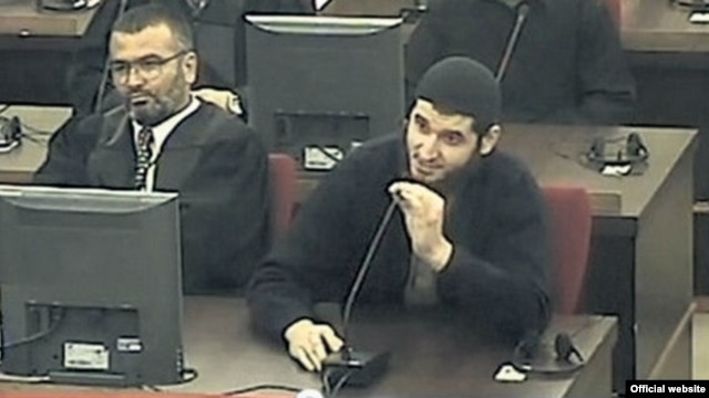 Mevlid Jasarevic (right) speaks in court during his trial.