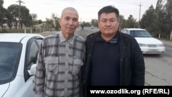 Uzbek journalist Salijon Abdurahmonov (left) with human rights activist Abdurahmon Tashanov upon his release from prison on October 4.