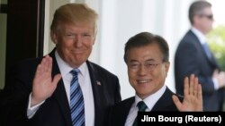 U.S. President Donald Trump (left) made his comments after meeting his South Korean counterpart Moon Jae-in (right) at the White House in Washington on June 30.