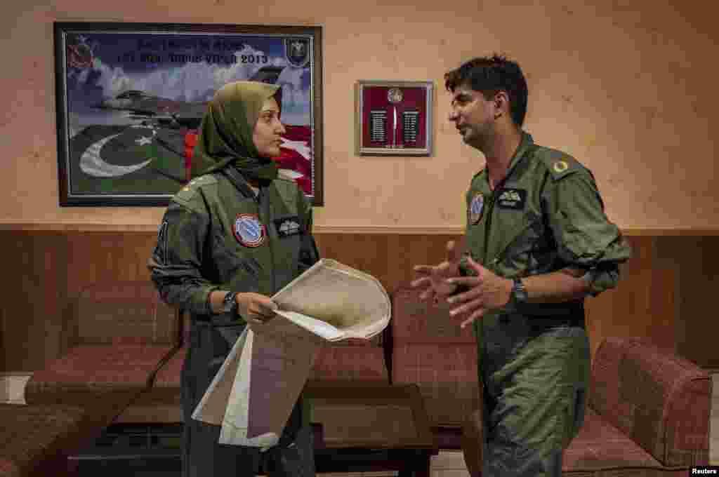 Ayesha Farooq talks with squad leader Imran Khan after their briefing at Mushaf base in Sargodha