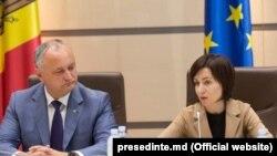 Președintele moldovean Igor Dodon şi şefa Guvernului Maia Sandu. 12 iunie 2019