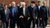 علی اکبر طبری (نفر دوم از راست) که متهم به فساد شده است، از مدیران معتمد صادق لاریجانی بوده است.