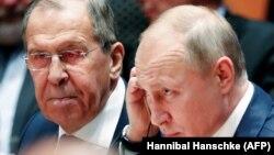 Владимир Путин и Сергей Лавров в Берлине на конференции по мирному урегулированию в Ливии. 19 января 2020 года