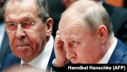 Russian President Vladimir Putin and Foreign Minister Sergei Lavrov listen during a Libya summit in Berlin on January 19.