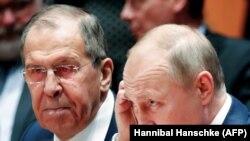 Președintele rus Vladimir Putin și șeful diplomației ruse, Serghei Lavrov