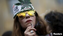 A woman smokes during a rally in support of the decriminalization of marijuana in Tbilisi in 2015.