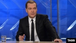Russian Prime Minister Dmitry Medvedev answers questions from journalists during his live interview to Russia's leading television channels on December 6.