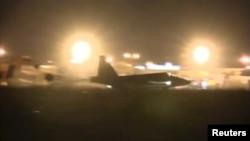 Российские боевые самолеты призмеляются на сирийском аэродроме. 1 октября