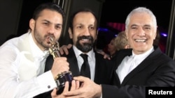"""A Separation"" director Asghar Farhadi is flanked by actor Peyman Maadi (left) and director of photography Mahmoud Kalari (right) after their announcement of best foreign language film in Los Angeles on February 26."