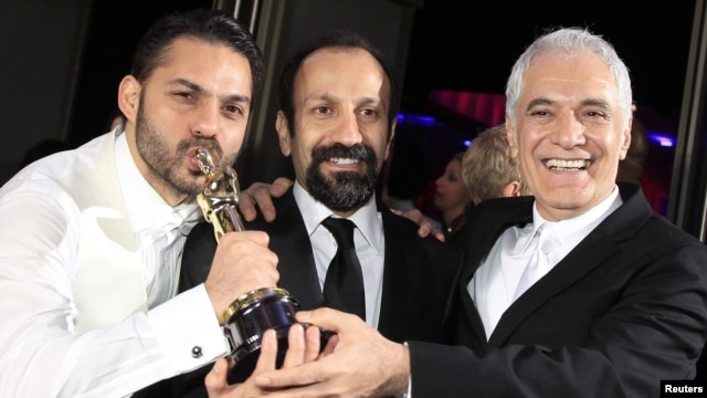 "Asghar Farhadi (center), director of the Iranian film ""A Separation,"" poses with actor Peyman Maadi (left) and director of photography Mahmud Kalari at the 84th Academy Awards in Hollywood after winning the Oscar for best foreign-language film in 2012."