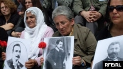 Turkey -- Turks hold up pictures of Armenian intellectuals rounded up and executed in 1915 during a public commemoration in Istanbul, 24Apr2010