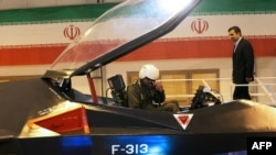 Iranian President Mahmud Ahmadinejad approaches the pilot of the Qaher F-313 during the unveiling ceremony. Experts question the quality of the material used to make the canopy.
