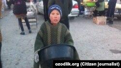Мальчик, подрабатывающий на одном из рынков в Кашкадарье.