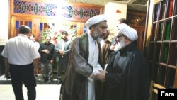 علی فلاحیان (دست راست) و مصطفی پورمحمدی.