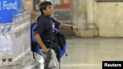 Mohammad Ajmal Kasab is pictured in Mumbai's main train station during the attacks.