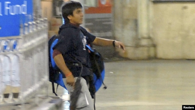 A grainy image shows Mohammad Ajmal Kasab at the Victoria Terminus railway station in Mumbai on November 26, 2008, when more than 160 people died at the hands of the attackers.