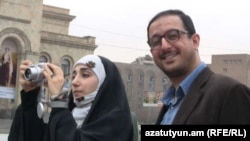 Armenia -- An Iranian couple takes pictures in Yerevan's Republic Square, 21Mar2011.