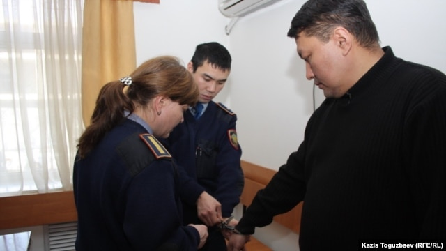 Askar Moldashev (right), brother of Daniyar Moldashev, director of the newspaper 'Golos Respubliki,' during his Almaty court appearance on March 1.