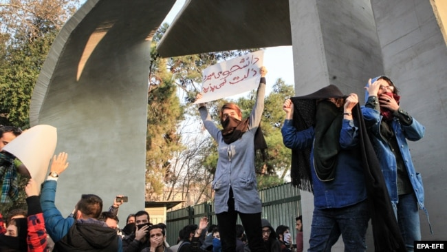 Iranian students clash with riot police during an anti-government protest around the University of Tehran, Iran, 30 December 2017
