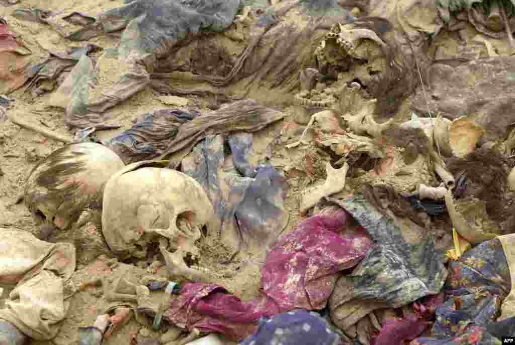 Remains recovered from a mass grave in the Al-Samawa desert, 270 kilometers south of Baghdad, April 2005. Evidence from this discovery and others like it formed the basis of Saddam Hussein's second trial.