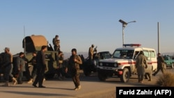 Afghan security force arrive near the site after a suicide bomber blew himself up inside a packed mosque on aa base in Khost on November 23.