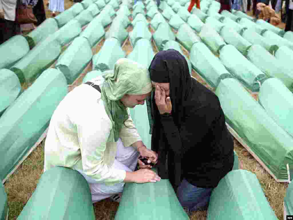 Bosnian Muslim women mourn during a funeral for 465 people slain in Srebrenica by Bosnian Serb troops - But Karadzic's most devastating legacy by far is the slaughter of nearly 8,000 unarmed Muslim men and boys in Srebrenica, eastern Bosnia, in 1995. The UN tribunal has charged Karadzic with genocide for the Srebrenica massacre, carried out by Bosnian Serb troops under his authority who overran a UN-protected Muslim enclave.