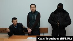 Aset Abishev (center) in court on November 30