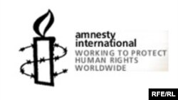 Amnesty International ұйымының белгісі. Көрнекі сурет.