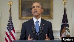 АҚШ президенті Барак обама Кубамен қарым-қатынасты қалпына келтіру жайлы мәлімдеме жасап тұр. Вашингтон, 17 желтоқсан 2014 жыл.