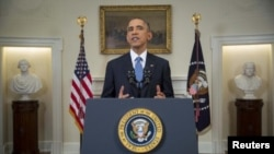 U.S. President Barack Obama announces more sanctions banning trade with Crimea.