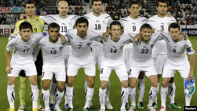 The Uzbek national soccer team poses for a group photograph during the 2011 Asian Cup.