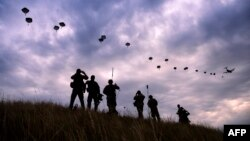 NATO paratroopers drop out of a U.S. Air Force Hercules during a military exercise in Bulgaria in July.