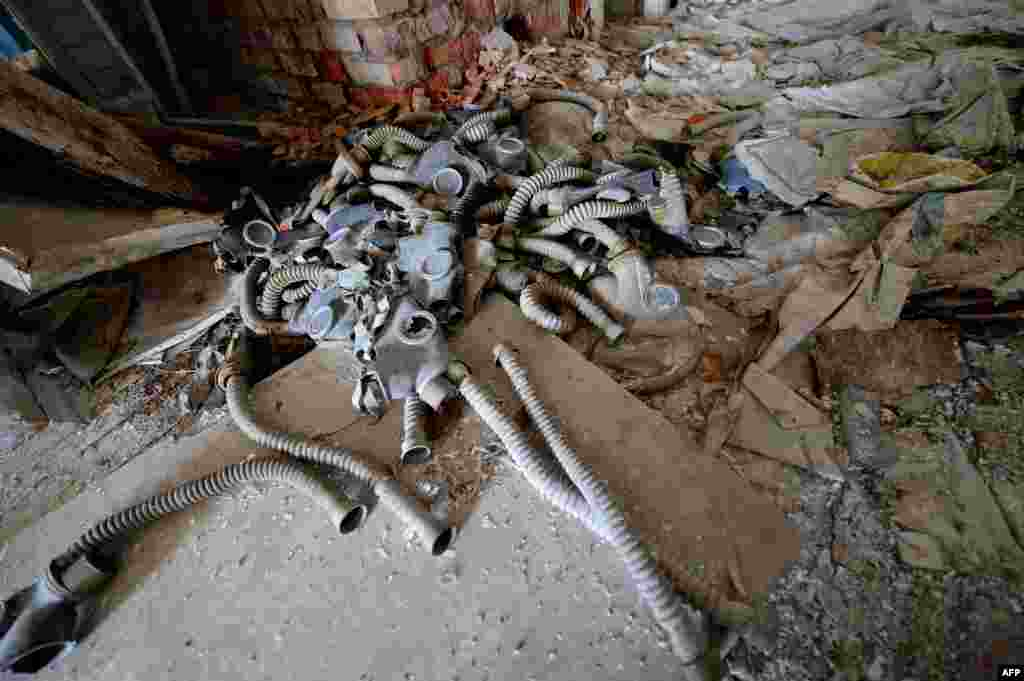 Gas masks lie on the floor in a school in the abandoned village of Orevichi, inside the exclusion zone around the Chornobyl nuclear reactor, some 390 kilometers from Minsk. The explosion at Reactor No. 4 on April 26, 1986, sent radioactive fallout into the atmosphere that spread across Europe, particularly contaminating Belarus, Ukraine and Russia. (AFP/Stringer)