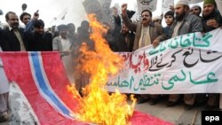 Supporters of an Islamic party in Pakistan in 2010 burn a Norwegian flag during a protest in Lahore against the republication of the controversial Muhammad caricatures.
