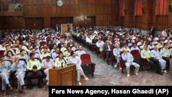 This photo released by the semi-official Iranian Fars News Agency, shows a general view of the court room where dozens of opposition activists and peaceful protesters are standing trial, in Tehran's Revolutionary Court, Iran, Aug. 25, 2009.