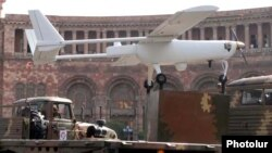 Armenia - An Armenian-made drone is driven through Yerevan's Republic Square during a military parade rehearsal, 19Sep2011.