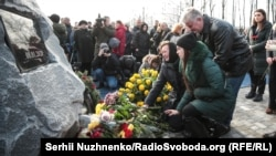 Mourners gather at a memorial to victims of the UIA plane crash at Kyiv's Boryspil Airport in February.