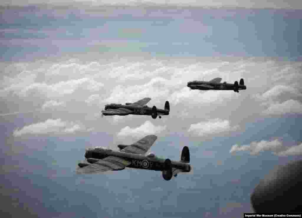 """British Lancaster bombers flying over Europe during World War II. By 1945, Britain's Royal Air Force had begun to target German cities with massive bombing raids intended to""""break the morale of the population which inhabits [them]."""" Earlier in the war, Nazi Germany had killed more than 40,000 Britons in its own bombing campaign on civilian centers."""