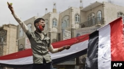 Yemen -- Demonstrators shout slogans during a protest against the regime of President in Sanaa, 17Mar2011