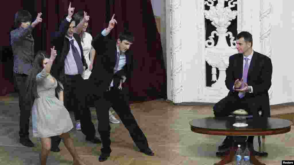 Russian billionaire and presidential candidate Mikhail Prokhorov (right) watches a performance staged by students from the Financial University under the Government of the Russian Federation in Moscow on February 14. (Reuters/Denis Sinyakov)
