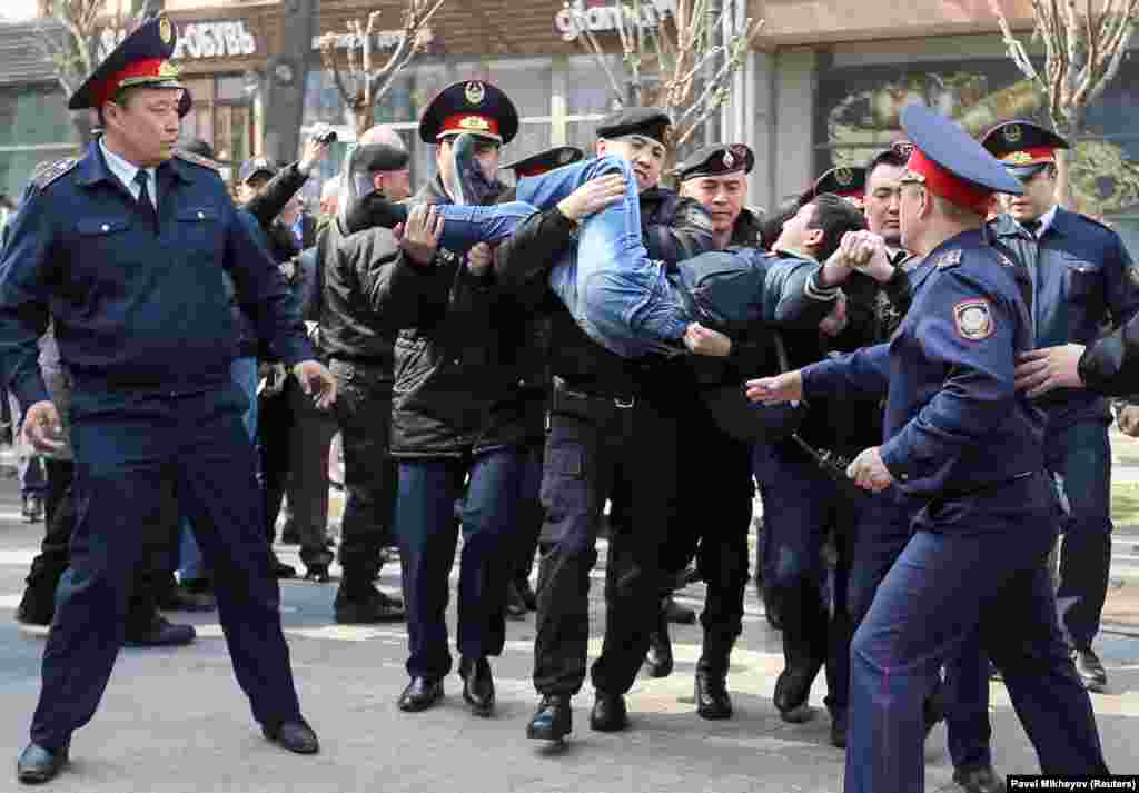 Police officers detain an anti-government protester during a rally in Almaty, Kazakhstan. Police detained dozens of people who were protesting the government's move to rename the Central Asian nation's capital after former President Nursultan Nazarbaev, just days after his surprise resignation. (Reuters/Pavel Mikheyev)