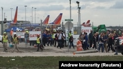 Travelers and airport workers were evacuated from the terminal after the airport shooting at Fort Lauderdale-Hollywood International Airport in Florida.