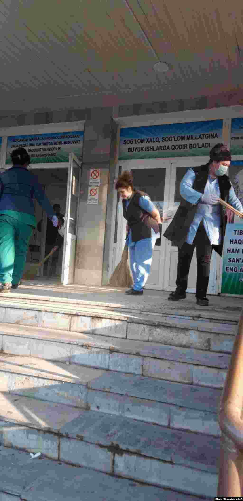 Workers outside a hospital in Tashkent, Uzbekistan