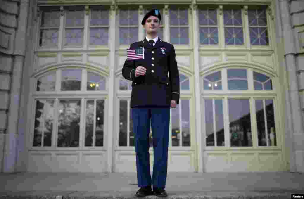 Vasily Sergeyevich Sirotin, originally from Russia and an active U.S. Army Reserve officer, poses for a photograph after becoming a U.S. citizen in a naturalization ceremony on the steps to the Ellis Island National Museum of Immigration at Ellis Island, New York. (Reuters/Mike Segar)