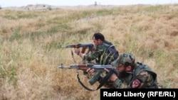 Afghan forces fighting Taliban militants in Kunduz.