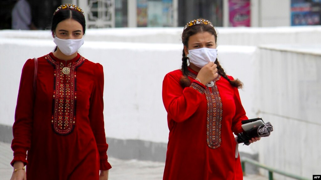 Turkmen women are seen wearing face masks in Ashgabat on July 13, where they had been banned just 2 week before.