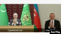 Azerbaijani President Ilham Aliyev (right) and Turkmen President Gurbanguly Berdymukhammedov supervised an online signing of the agreement on January 21.